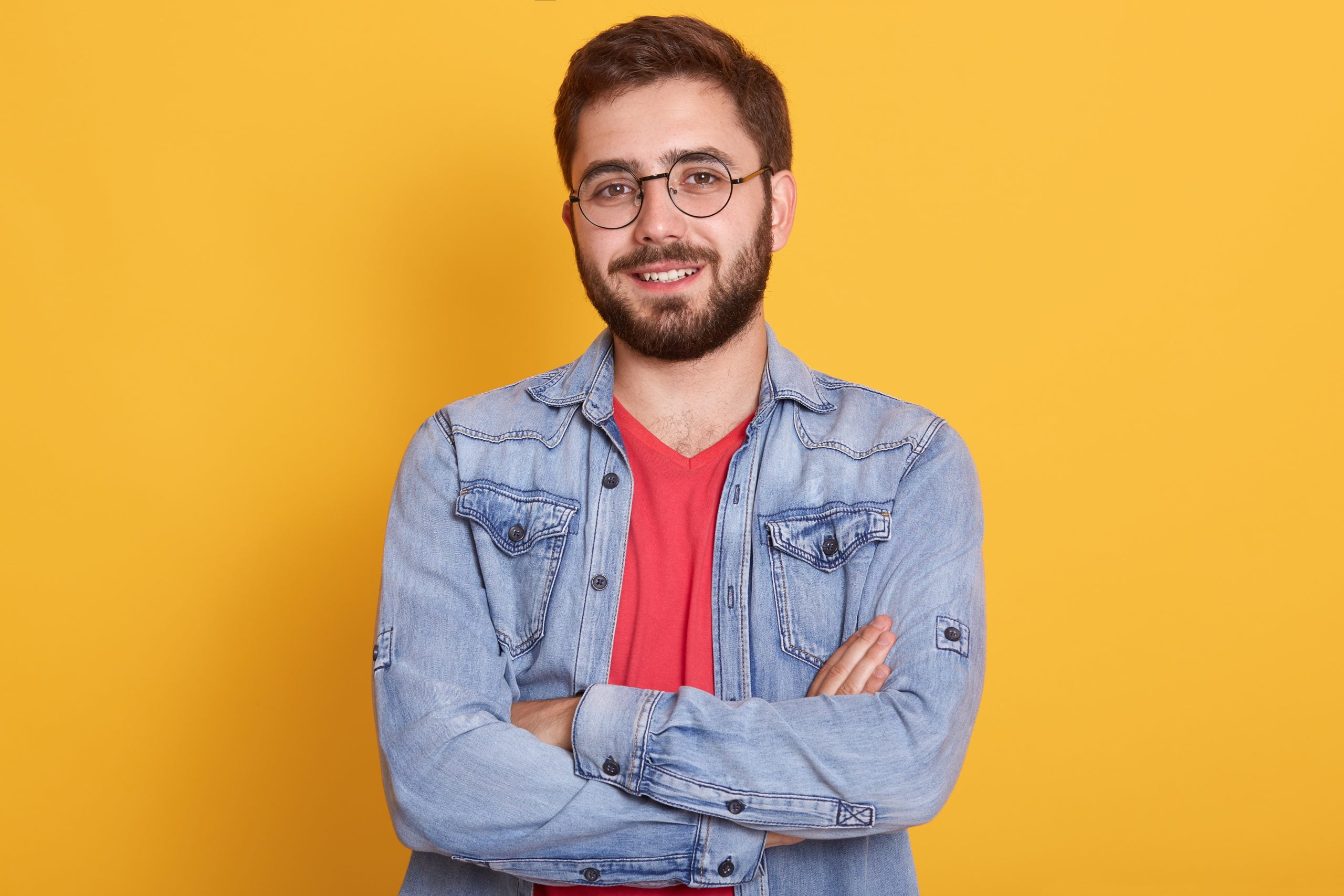 indoor picture cheerful handsome young man having folded hands looking directly smiling sincerely wearing casual clothes scaled
